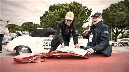 Dr. Porsche signing autographs